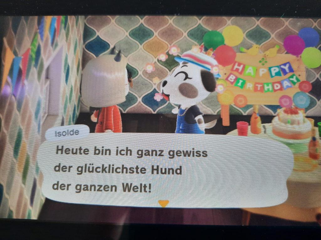 """Ein Animal-Crossing-Screenshot, bei dem ein Hundecharakter sagt """"Heute bin ich ganz gewiss der glücklichste Hund der ganzen Welt!"""""""